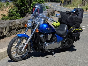 Vulcan 900 Custom stacked up with camping gear